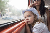 Sad and tired girl looks through the window in the tram — Foto Stock