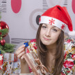 Girl disappointed a little gift, lying near the Christmas tree — Stock Photo