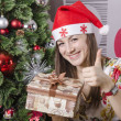 The girl liked new year's gift — Stock Photo #37162137