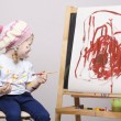 Portrait of a girl artist at the easel — Stock Photo