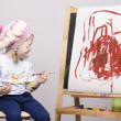 Portrait of a girl artist at the easel — Stock Photo #40723111