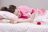 Sleeping girl and the bed gave a ring — Stock Photo