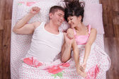 Young girl and guy woke up in bed sipped — Stock Photo