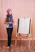 The girl in image of  artist at easel — Stock Photo