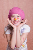 Portrait of a girl covered in paint — Stockfoto