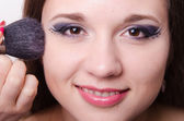 Model is applied to the face powder — Photo