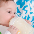 Baby drinking milk formula from a bottle — Stock Photo #47683729