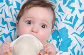 Six-month girl drinking milk formula from a bottle — Stock Photo