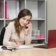 Business woman calling by phone in the workplace — Stock Photo #50419793