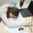 Tired woman asleep on a workplace at office — Stock Photo #50420279