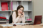 Business woman with dread calling on phone in office — Stock Photo