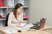 Business woman considers bribe in an envelope — Stock Photo