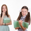 Trainee writes in a notebook, answering homework — Stock Photo