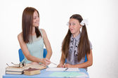Mom and daughter doing homework together — Stock Photo