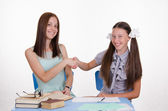 Teacher and student happily shake hands with each other — Stock Photo