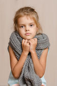 Diseased five year old girl wrapped in a scarf — Stock Photo