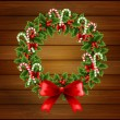 Christmas wreath on wood background - Stock Vector