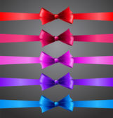 Colorful ribbons with bows — Stock Vector