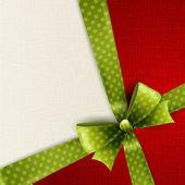 Christmas card with green polka dots bow — Stock Vector