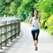 Young asian woman jogging — 图库照片