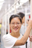 Asian woman in metro — Stock Photo