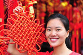Woman with red New Year decoration — Stock Photo