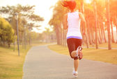 Woman jogging at tropical park — Stock Photo