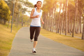Woman running at tropical park — Stock Photo