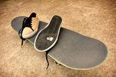 Broken sneakers on a skateboard — Stock Photo