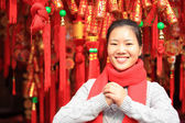 Young asian woman wishing you a happy chinese new year — Стоковое фото