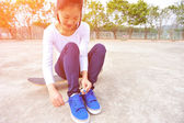 Young woman sit on skateboard — Stock Photo