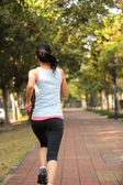 Woman runner — Stockfoto