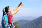 Young woman hiker use smart phone — Stock Photo
