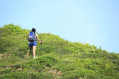 Young asian woman hiker climbing — Stock Photo