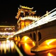 Beautiful night view of bridge at Fenghuang — Stock Photo