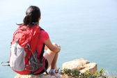 Hiking woman relax and sit seaside — Stock Photo
