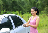 Woman with  car — Stock Photo