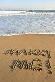 Merry me! words drawn on sand — Stock fotografie