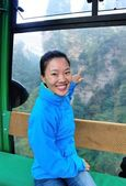 Woman tourist travel in cable car — Stock Photo