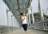 Woman jogging in the city — Stock Photo