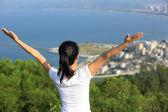 Cheering woman stand mountain peak — Stock Photo