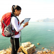 Hiking woman stand use digital tablet — Stock Photo