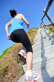 Woman running up on the  stairs — Foto Stock