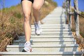 Woman running on mountain stairs — Stock Photo