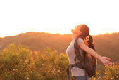Thankful woman open arms to the sunrise — Stock Photo