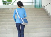 Adult student running at stairs — Stock Photo