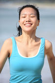 Asian woman running at beach — Stock Photo