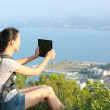 Woman hiker use tablet pc — Stock Photo