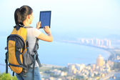 Young asian woman hiker use digital tablet — Stok fotoğraf