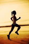 Fitness woman jogging at sunrise — Stock Photo